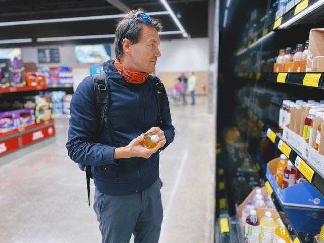 Man in store looking at items on shelf